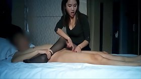 Incomparable asian youthful battle-axe giving a handjob