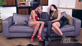 Two naughty babes give a rimjob and blowjob to one handsome phase
